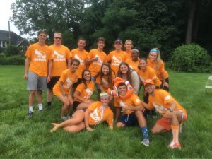 "Group photo of incoming freshman dressed in their team color ""Goldfish"""