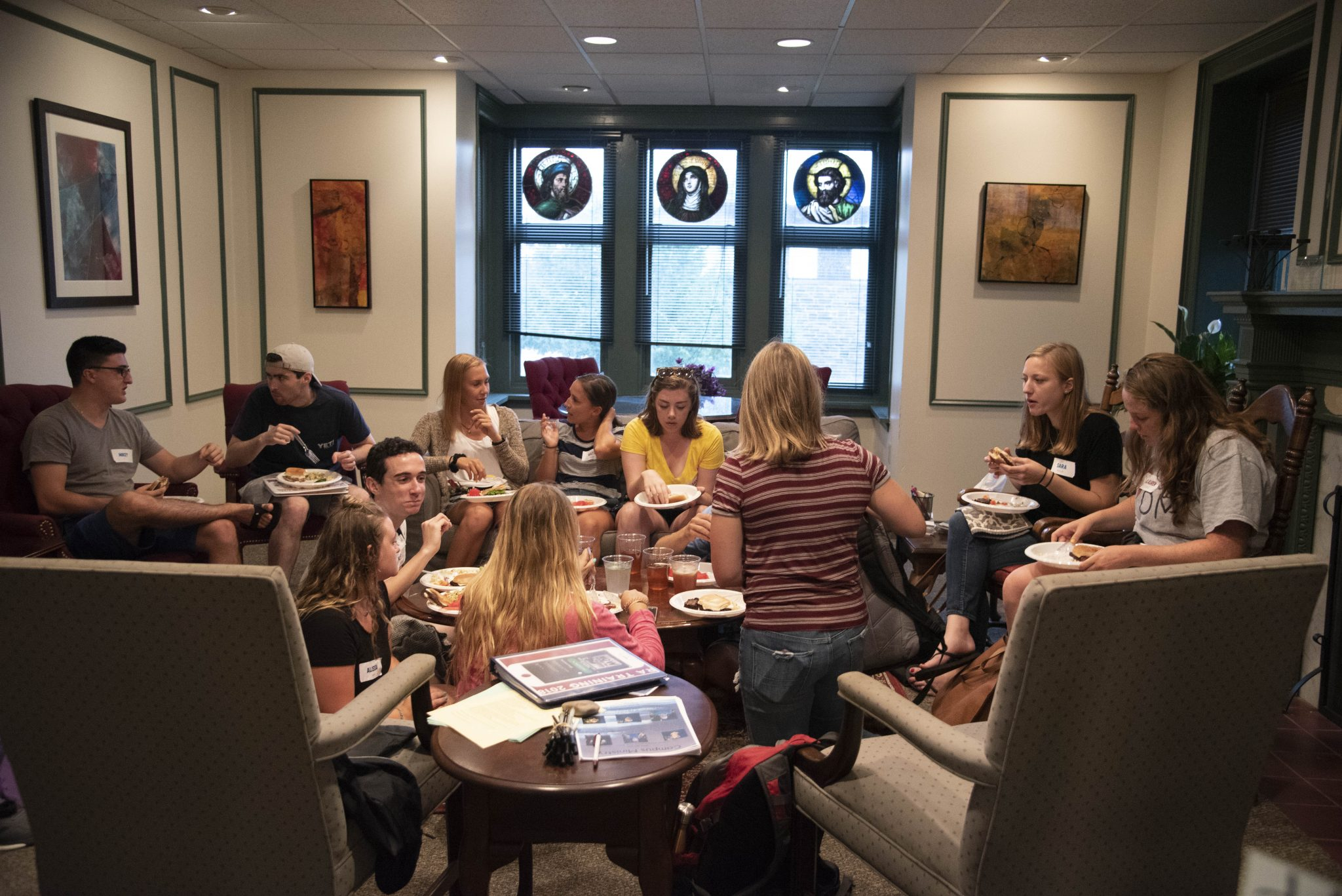 Students sitting in the Community Room of Wolfington Hall
