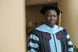Saye Clarence Gono Jr in his Ed.D. graduation gown