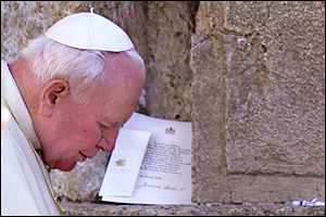 Pope Saint John Paul II praying at the Western Wall.