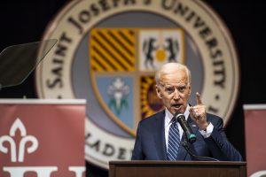 VP Joseph R. Biden Jr. speaks in front of a the Saint Joseph's University seal.
