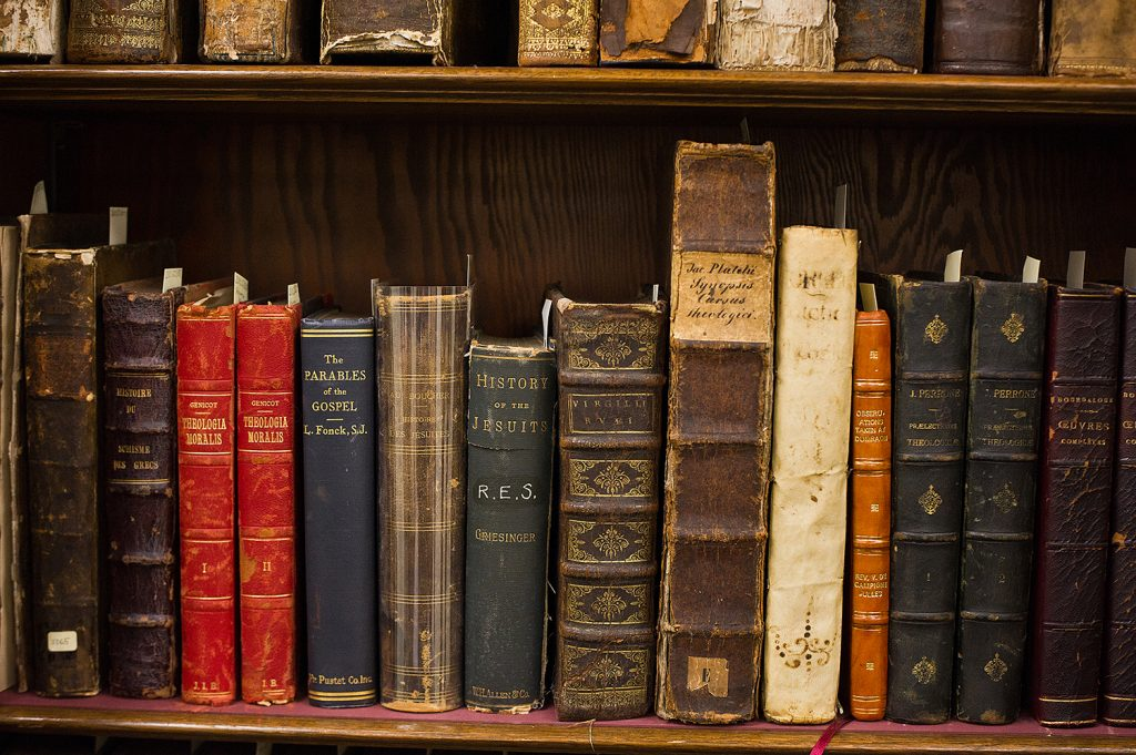 Old books on a shelf.
