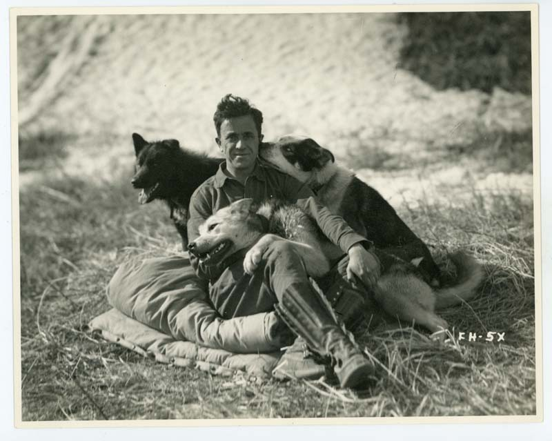 Father Bernard Hubbard, ca. 1935, with three of his dogs:  Wolf, three-quarter timber wolf; Katmai, great leader on the Yukon trails; and Mageik, herder of the pack and clown in many a tight place.