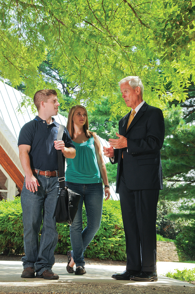 Maguire talks with students on campus.