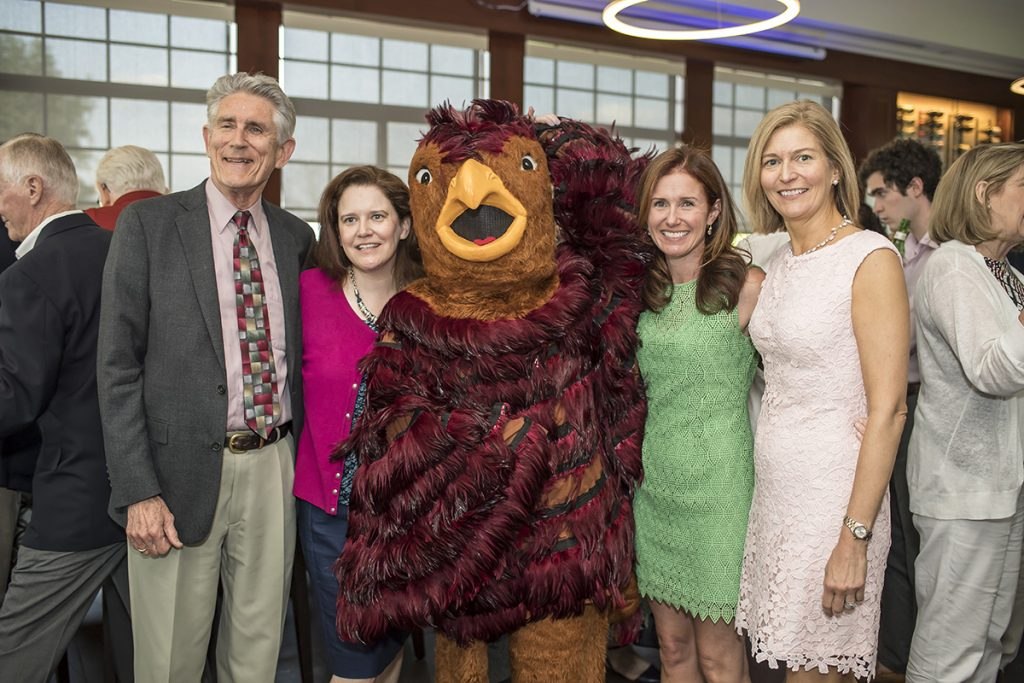 Photo of Dick Kelly, Monique Kelly, their daugthers and the Hawk mascot