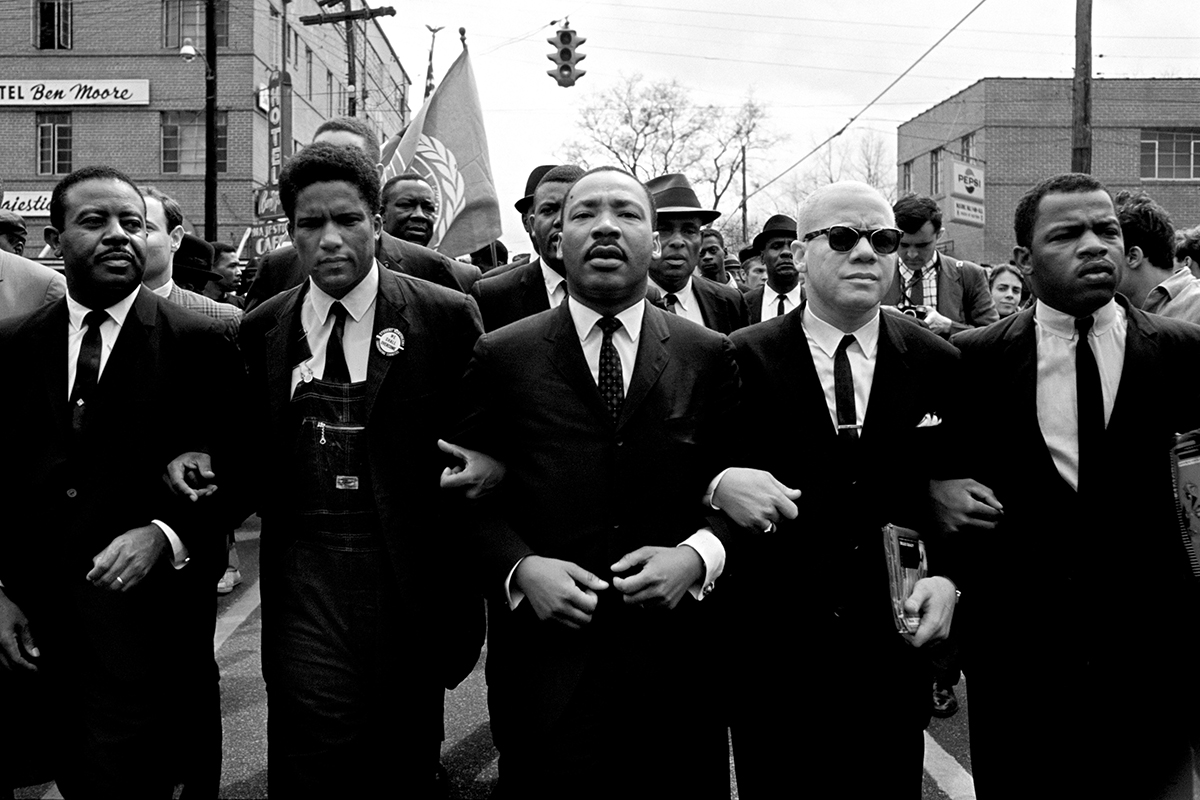 Lewis (far right) joins King (center) on the march from Selma to Montgomery.