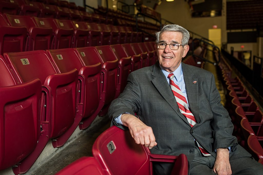 Don DiJulia looks to the left of the camera, sitting in the stands at Hagan Arena.