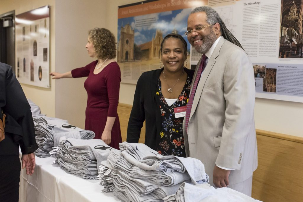 The first 200 people to arrive at the 50th Anniversary Commemoration received a special edition t-shirt and greetings from Susan Liebell, associate professor of Political Science, Natalie Walker Brown, director of Student Inclusion & Diversity, and Wadell Ridley, assistant vice president for Government and Community Relations.