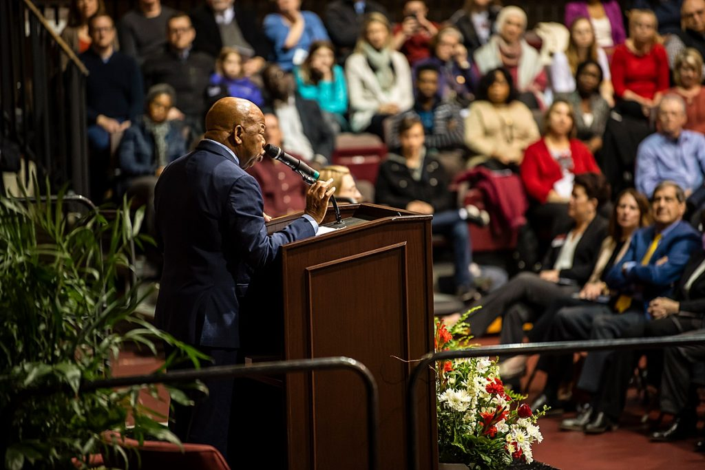 John Lewis, from the side, speaking from a podium in Hagan Arena.
